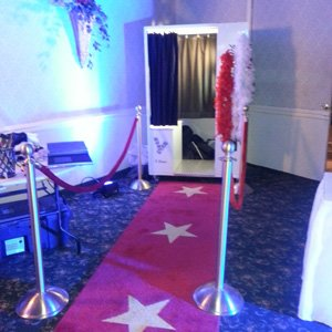 Booth with red carpet and ropes
